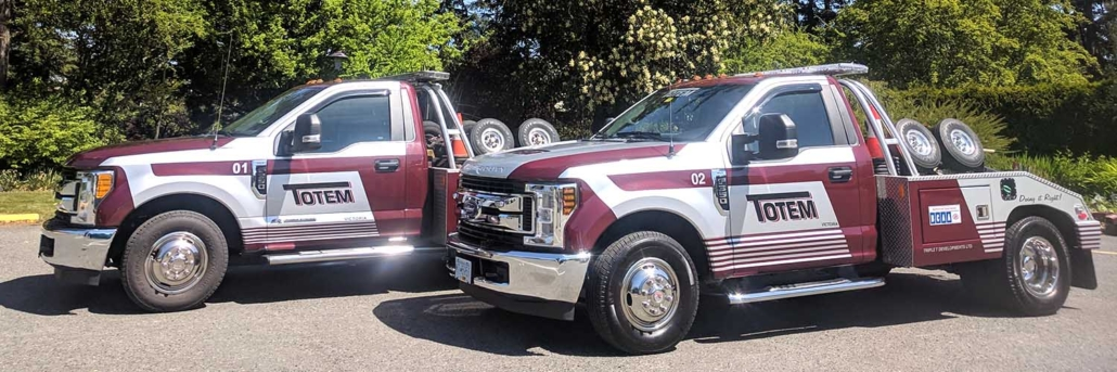 two red Totem Towing tow trucks